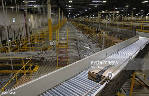 A box moves along a conveyor belt at the Amazoncom fulfillment center in Kenosha Wisconsin US on Tuesday Aug 1 2017 Amazoncom Inc held a giant job...