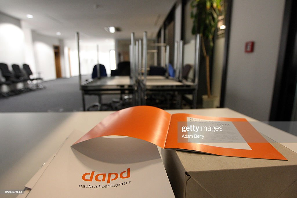 A box of brochures about the German news agency dapd lies on a table in a room full of upturned furniture in the company's offices on March 4, 2013 in Berlin, Germany. The country's second-largest news agency, dapd, was forced to declare insolvency for the second time in five months on March 1.