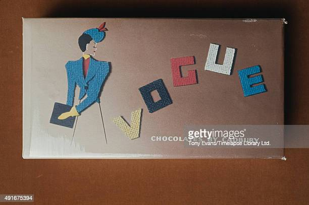 A box of Cadbury's Vogue chocolate illustrated with a lady in a fashionable jacket circa 1950
