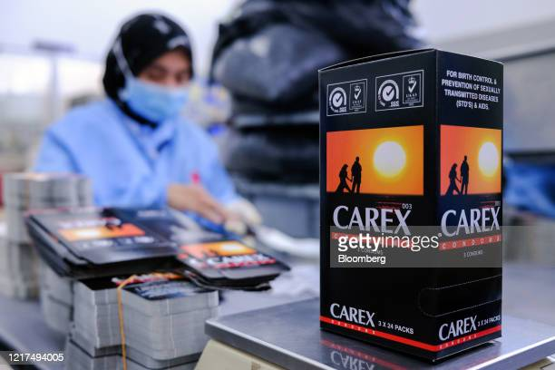 Box of Carex condoms sit on the production line at a Karex Bhd. Facility in Port Klang, Selangor, Malaysia, on Wednesday, June 3, 2020. Karex, the...