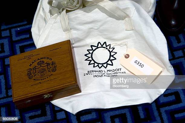 A box of cigars and a bag are displayed during a media preview for an auction which includes jewelry and other personal items belonging to Bernard...