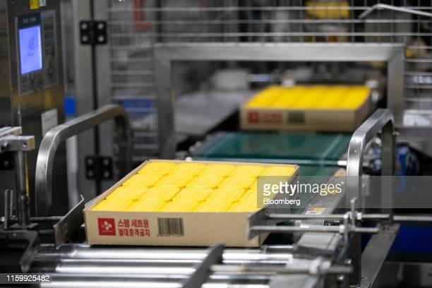 A box of CJ CheilJedang Corp  Spam ham cans move along a