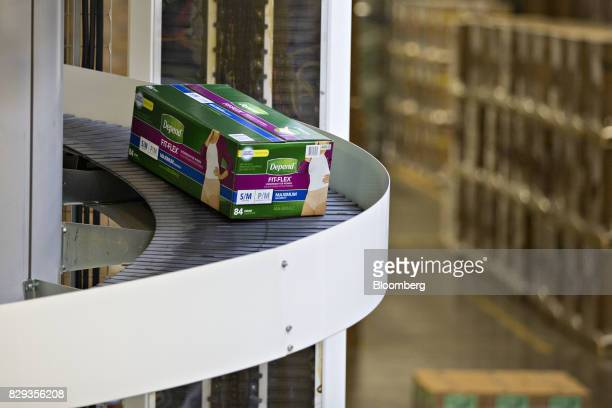 A box of Depend adult diapers moves along a conveyor belt during production at the KimberlyClark Corp Neenah Cold Spring facility in Neenah Wisconsin...