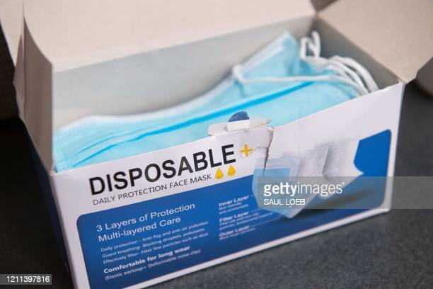 Box of disposable face masks to protect against COVID-19, known as coronavirus, are seen ahead of a press conference by US Speaker of the House Nancy...
