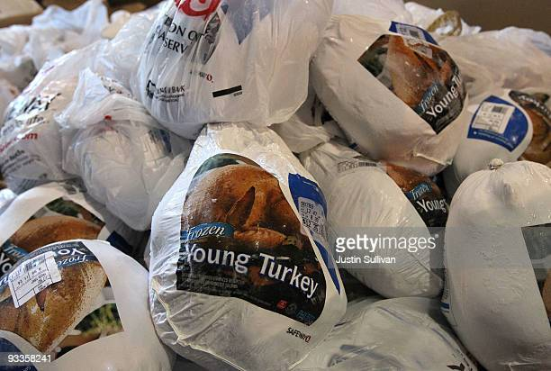 A box of donated turkeys waits to be distributed at the Alameda Food Bank November 24 2009 in Alameda California Hundreds of needy people lined up...