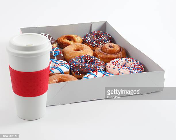 A box of donuts and a cup of coffee