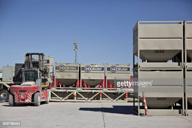 A box of frac sand is loaded onto a feeding machine near six Chevron Corp oil wells being readied for hydraulic fracturing in the Permian Basin near...