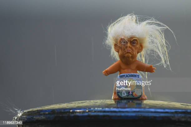 A box of Impeachmints peach flavored mints referring to US President Donal Trump seen in front of a vinyl doll of President Trump on display at...