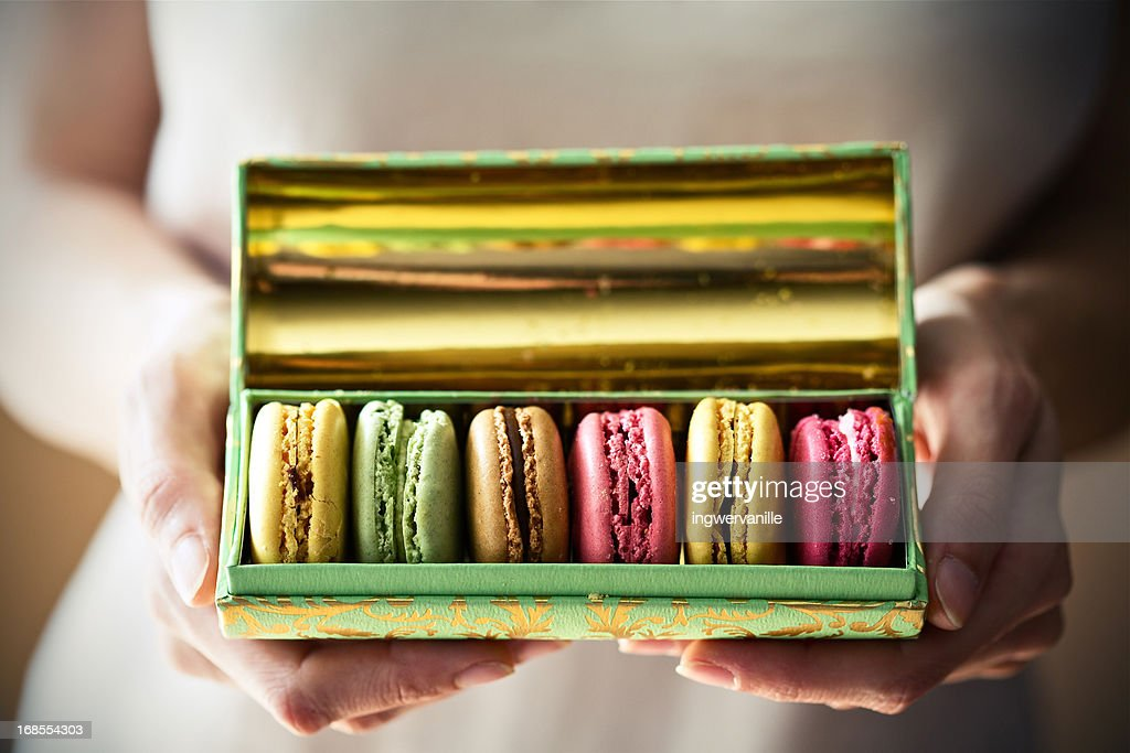 A box of macarons in hands : Stock Photo