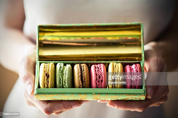 A box of macarons in hands