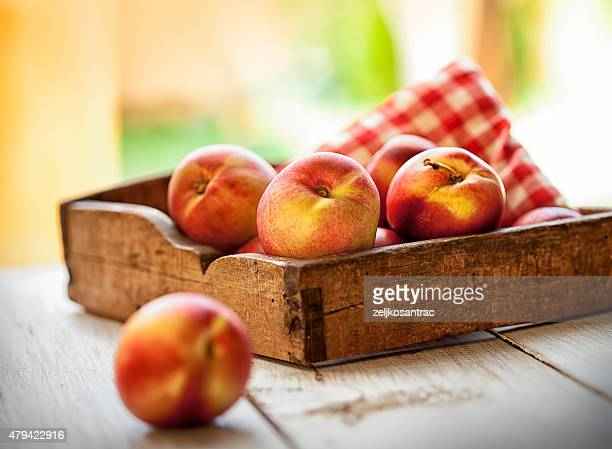 box of nectarines - peach stock photos and pictures