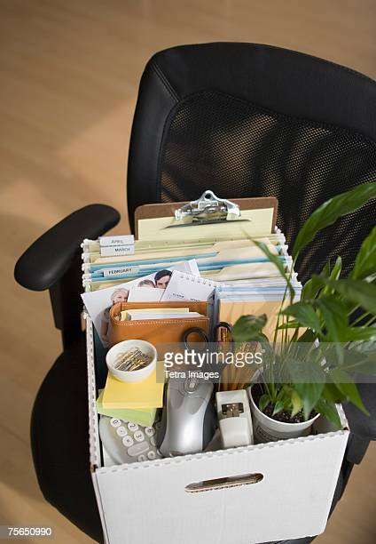 box of office items on chair - belongings stock photos and pictures