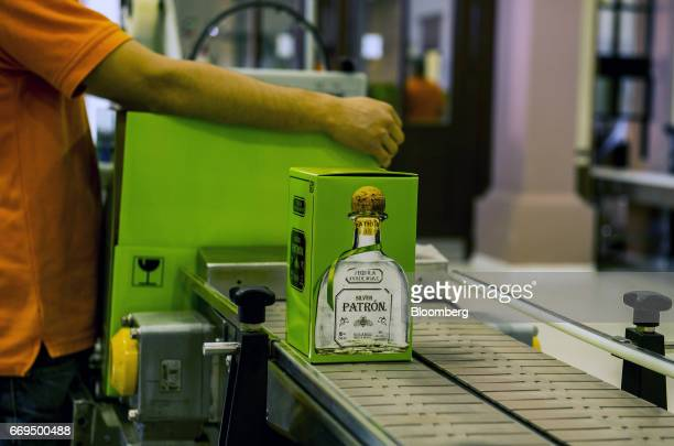 A box of Patron Spirits Co brand Silver Tequila moves down a conveyor belt at the company's distillery in Atotonilco El Alto Jalisco Mexico on...