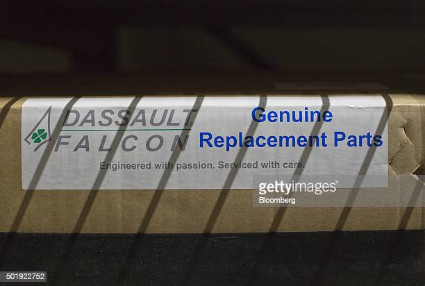 A box of replacement parts for a jet sits on a shelf in the Dassault Aviation SA Falcon Jet parts distribution center at Teterboro Airport in...
