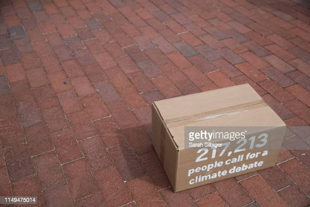 A box of signed petitions is seen in front of the Democratic National Committee headquarters during a Greenpeace rally to call for a presidential...