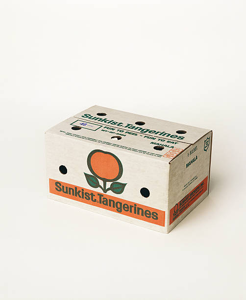 Box of tangerines on white background, close-up