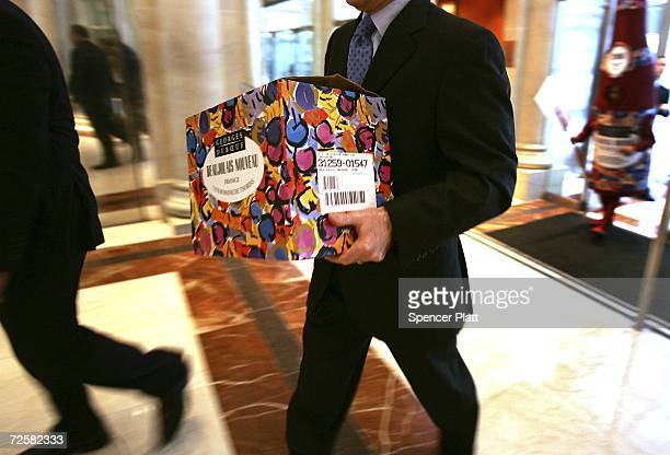 A box of this season's Beaujolais Nouveau is carried to an uncorking gathering for the French wine November 16 2006 in New York City While the...