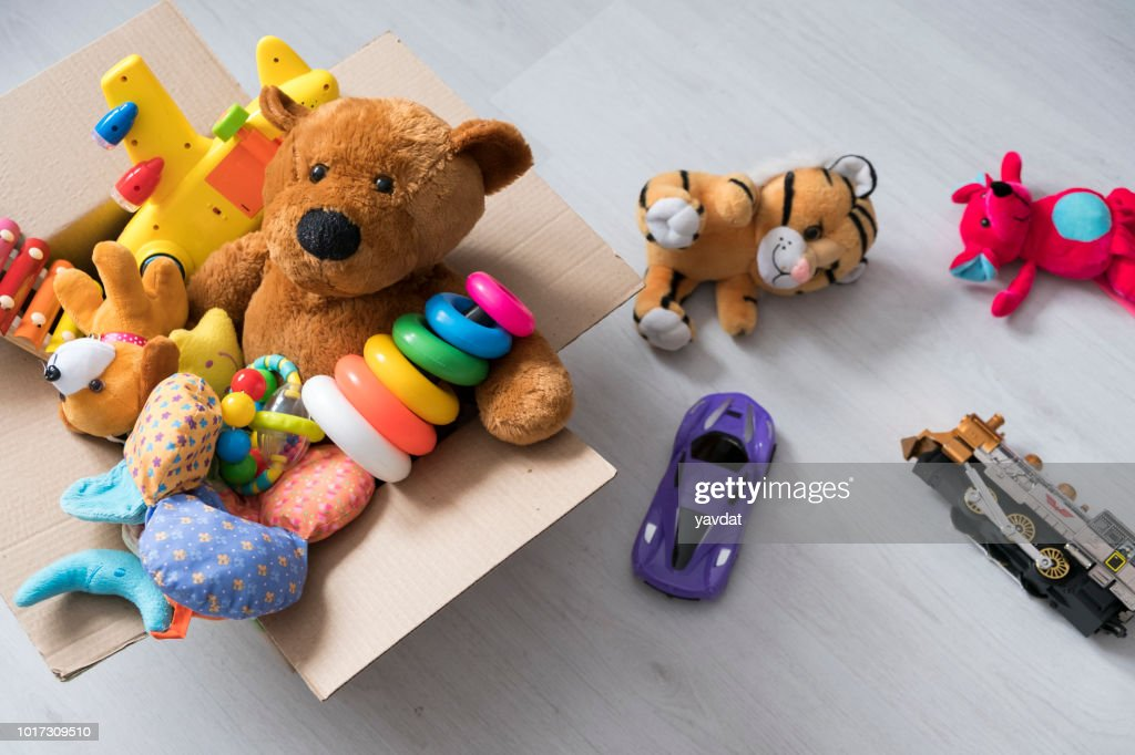 box of toys on the floor. Teddy bear in box,vintage tone. charitable contribution. donation. beneficence : Stock Photo