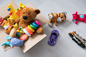 box of toys on the floor. Teddy bear in box,vintage tone. charitable contribution. donation. beneficence