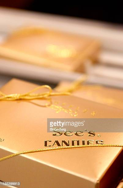 A box of truffles sit on the production line at the See's Candies Inc packing facility in South San Francisco California US on Thursday Dec 8 2011...