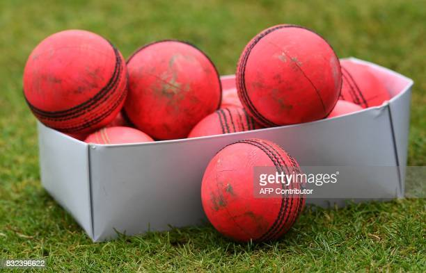 Box of used pink cricket balls are pictured on the pitch on the eve of the first day of the first cricket Test Match between England and the West...