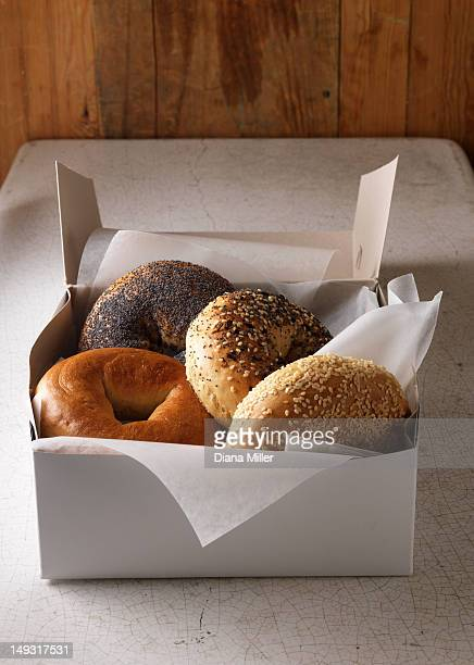 box of various bagels - bagels stock pictures, royalty-free photos & images