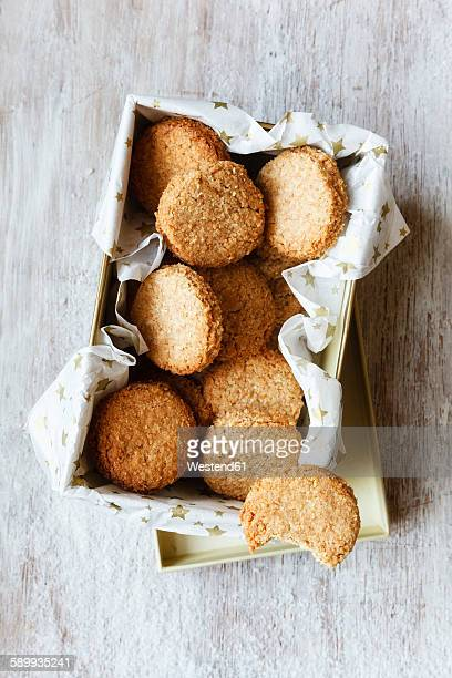 Box of whole grain cocos cookies on wood