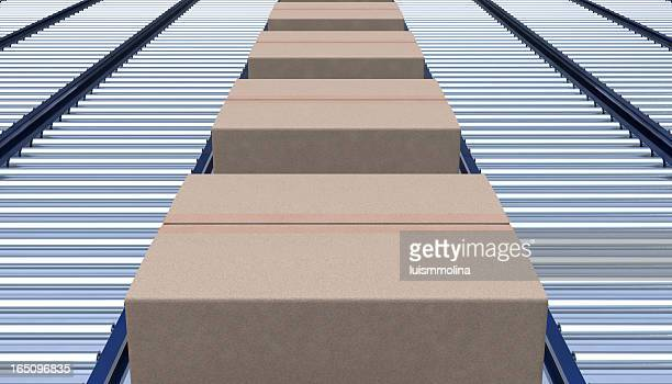 box on a conveyer belt - metallic belt stock pictures, royalty-free photos & images