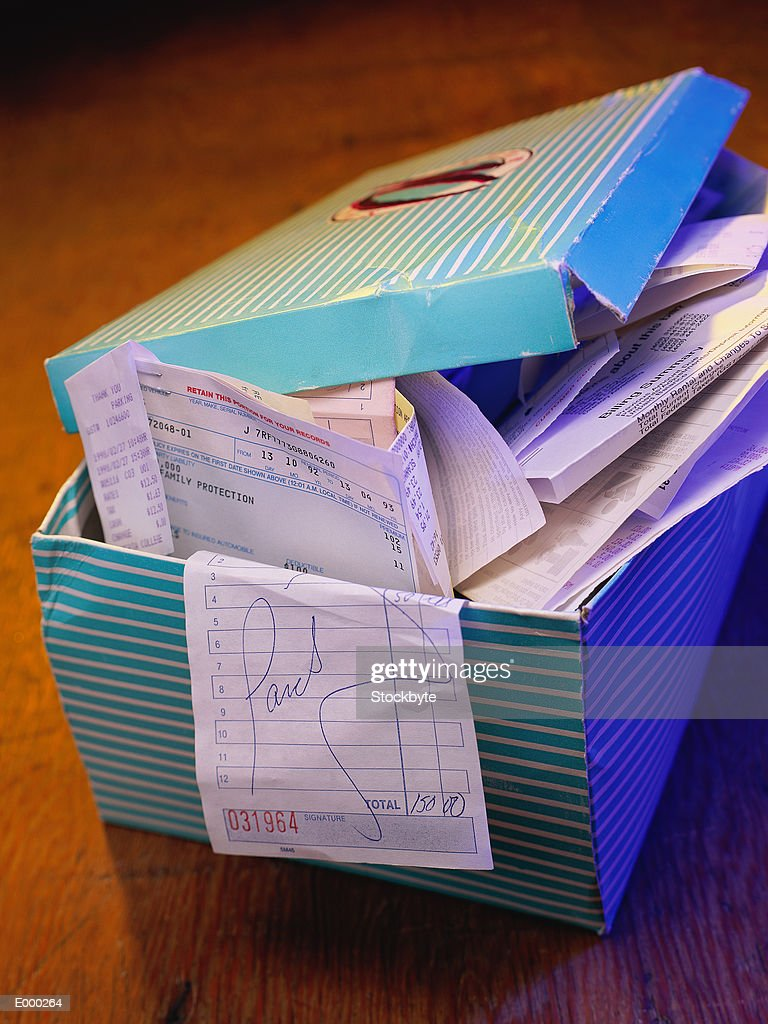 Box overflowing with receipts : Stock Photo