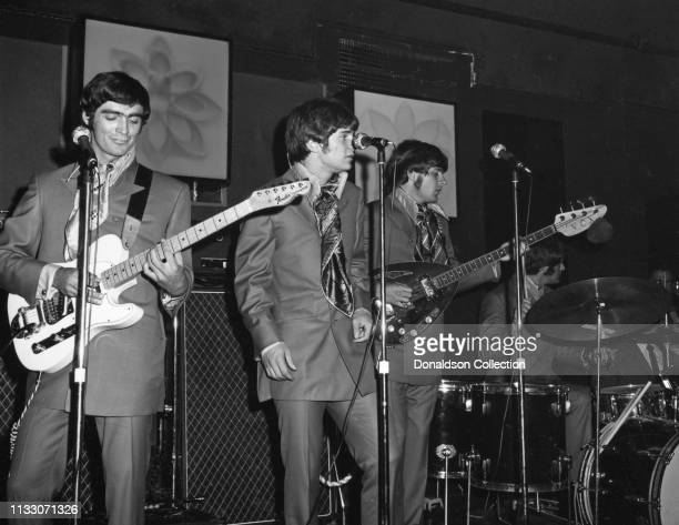 Box Tops members guitarist Gary Talley, drummer Thomas Boggs, bassist Rick Allen, and singer Alex Chilton performs onstage at the Arthur Club at a...