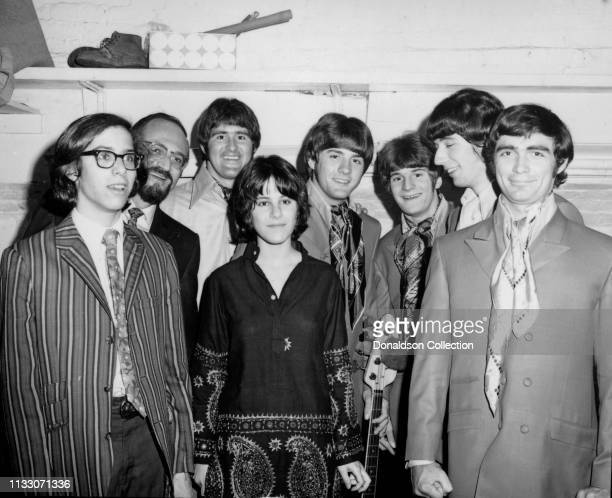 Box Tops members guitarist Gary Talley drummer Thomas Boggs bassist Rick Allen and singer Alex Chilton pose for a portrait with attendees at the...