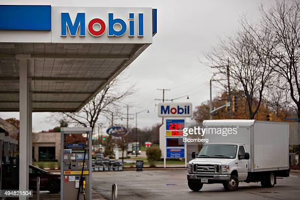 A box truck enters an Exxon Mobil Corp gas station in Rockford Illinois US on Wednesday Oct 28 2015 Exxon Mobil Corp is scheduled to report quarterly...