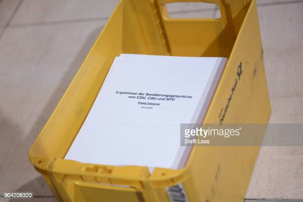 A box with the final version of the results of the preliminary coalition talks by the CDU CSU and SPD after statements following allnight preliminary...