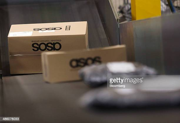 Boxed customer orders travel along a conveyor belt ahead of shipping at Asos Plc's distribution warehouse in Barnsley UK on Tuesday April 22 2014...