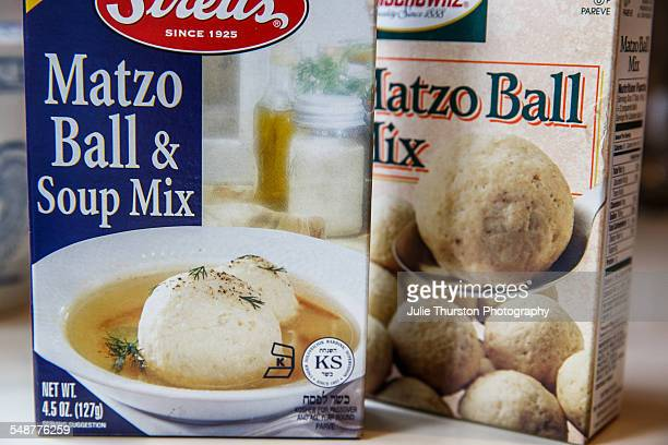 Boxed Jewish traditional Matzo Ball and soup mix on a kitchen counter Two different brands of convenient prepared mix ready to boil and serve for...