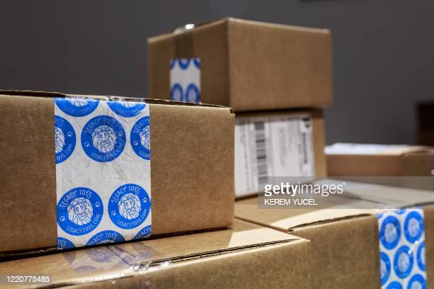 Boxed orders ready to ship are seen at the Legacy Toys store at the Mall of America on June 16, 2020 in Bloomington, Minnesota. - The US economy...