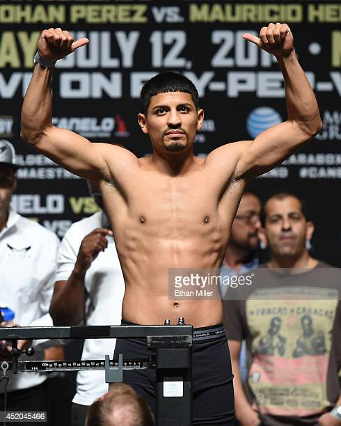 Boxer Abner Mares poses on the scale during his official weighin at the MGM Grand Garden Arena on July 11 2014 in Las Vegas Nevada Mares will meet...