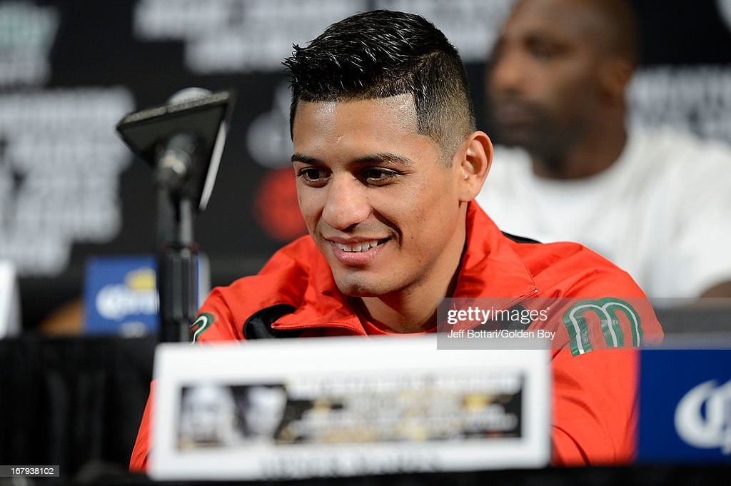 Boxer Abner Mares sits on stage during the final news conference for his bout against Daniel Ponce De Leon at the MGM Grand Hotel/Casino on May 2, 2013 in Las Vegas, Nevada. Mares will challenge Ponce De Leon for the WBC featherweight title.