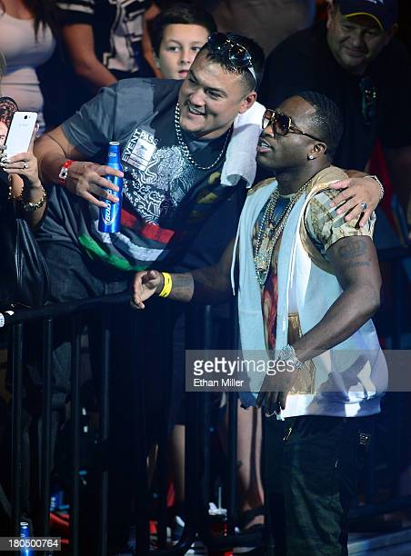 Boxer Adrien Broner poses with a fan as he is introduced at the official weighin for boxers Floyd Mayweather Jr and Canelo Alvarez at the MGM Grand...