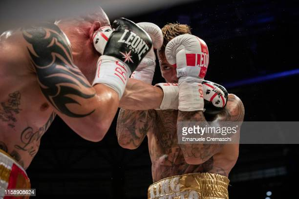 Boxer Alessandro Goddi throws a punch at Daniele Scardina during their IBF International Super-Middleweight Championship bout at Allianz Cloud arena...