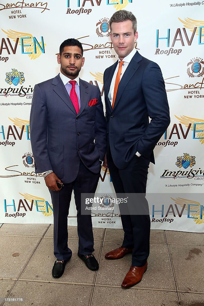 Boxer Amir Khan and TV Personality Ryan Serhant attend Amir Khan & Faryal Makhdoom's Welcome To New York Party at Haven Rooftop at Sanctuary Hotel on July 8, 2013 in New York City.
