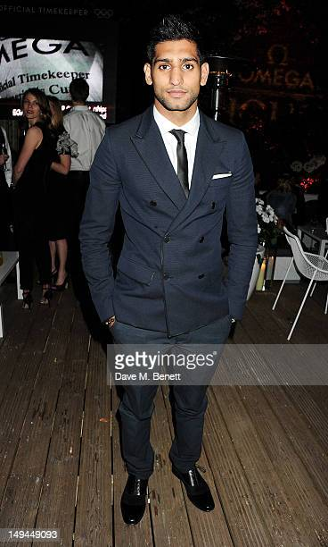 Boxer Amir Khan attends the private opening of OMEGA House OMEGA's official residence during the London 2012 Olympic Games at the House of St...
