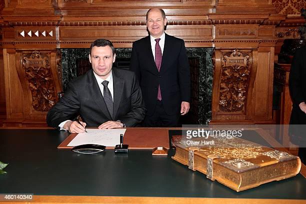 Boxer and Acting Mayor of Kiev Vitali Klitschko Signs Hamburg's Golden Book at the City Hall of Hamburg on December 8 2014 in Hamburg Germany