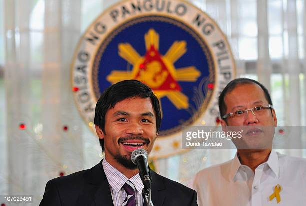 Boxer and congressman Manny Pacquiao addresses the audience at Malacanang Palace in Manila following his win of the WBC super welterweight crown...