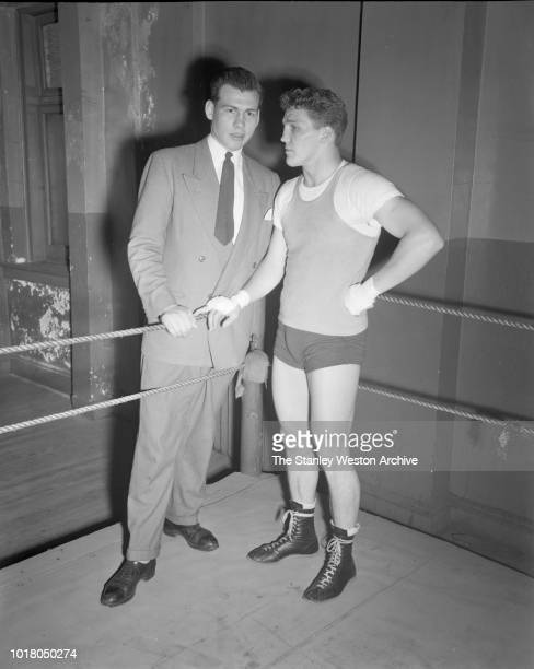 A boxer and his manager pose for a portrait in Stillman's Gym circa 1955 in New York City New York