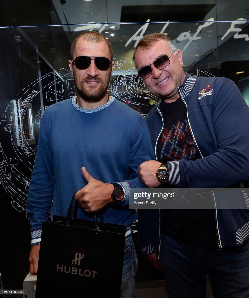 Boxer and Hublot ambassador Sergey Kovalev (L) and boxing trainer Egis Klimas visit the Hublot Boutique at The Forum Shops at Caesars on June 18, 2017 in Las Vegas, Nevada.
