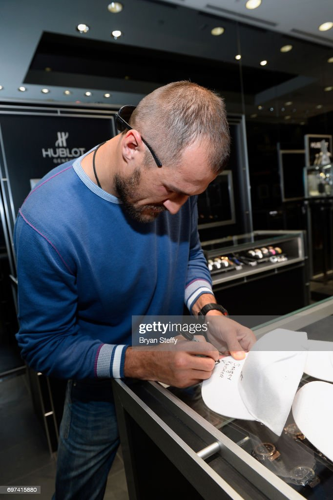 Boxer and Hublot ambassador Sergey Kovalev autographs Hublot baseball hats during his visit to the Hublot Boutique at The Forum Shops at Caesars on June 18, 2017 in Las Vegas, Nevada.