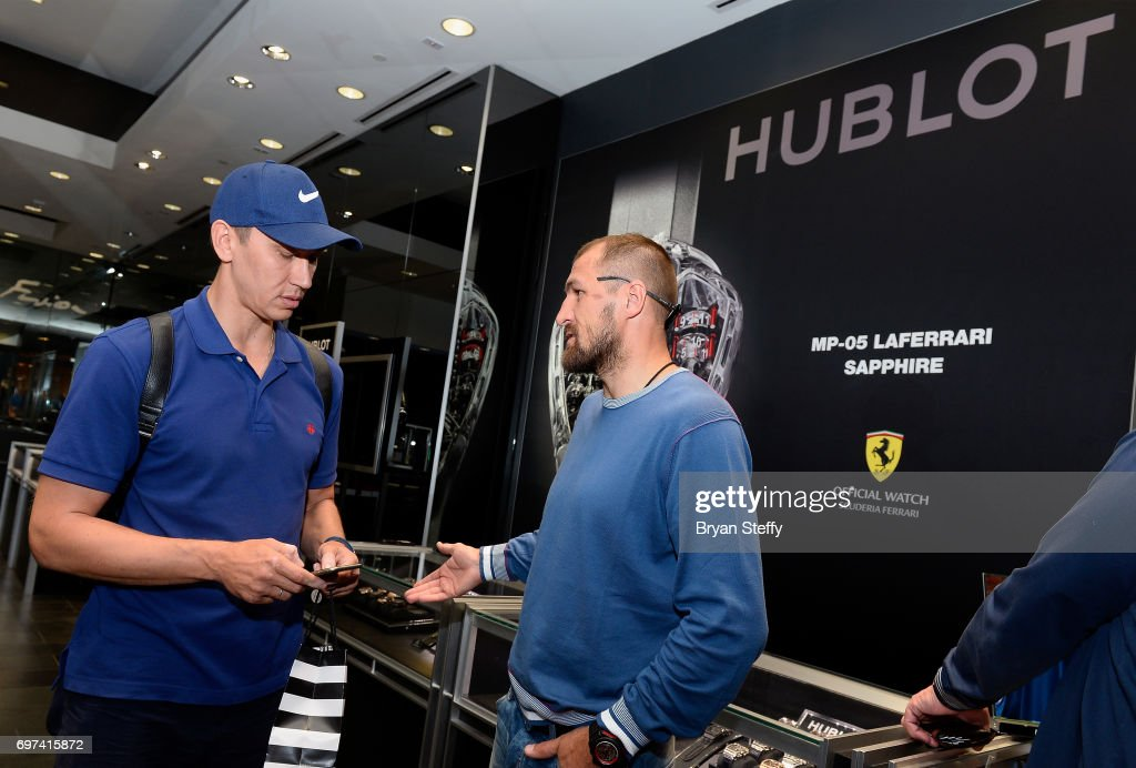 Boxer and Hublot ambassador Sergey Kovalev (R) greets a fan during his visit to the Hublot Boutique at The Forum Shops at Caesars on June 18, 2017 in Las Vegas, Nevada.