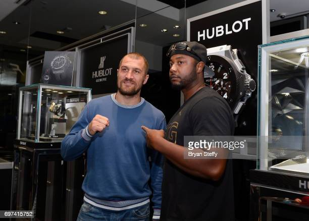 Boxer and Hublot ambassador Sergey Kovalev poses with a fan during his visit to the Hublot Boutique at The Forum Shops at Caesars on June 18 2017 in...