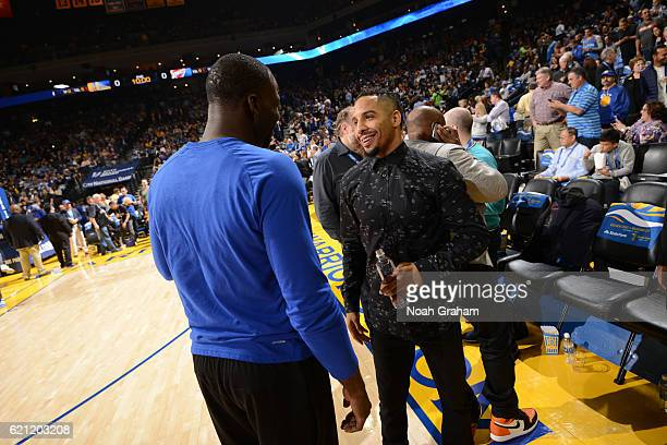 Boxer Andrew Ward talks with Draymond Green of the Golden State Warriors before the game against the Oklahoma City Thunder on November 3 2016 at...
